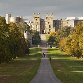 Windsor Castle viewed along Long Walk in Windsor Great Park in E